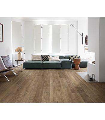 Parquet laminado de roble riva natural de la marca quick-step de la serie eligna en un ambiente de habitación.