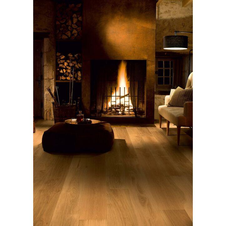 Parquet de madera natural de Quick-Step de la colección palazzo pal1472S Roble miel aceitado en un ambiente de habitación.