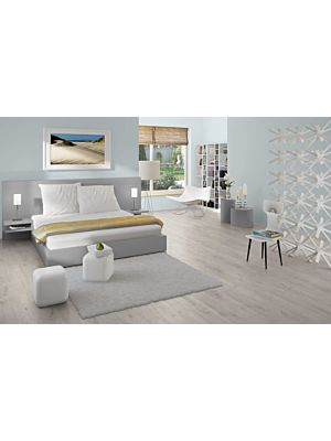 Parquet laminado pino patras gris de Egger Home en un ambiente de habitación. Código EHL072.