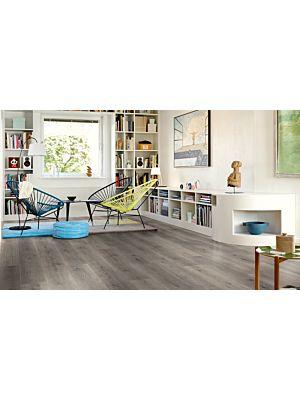 parquet laminado de la marca pergo de la serie living expression roble gris mountain L0301-01802 en un ambiente de habitación.
