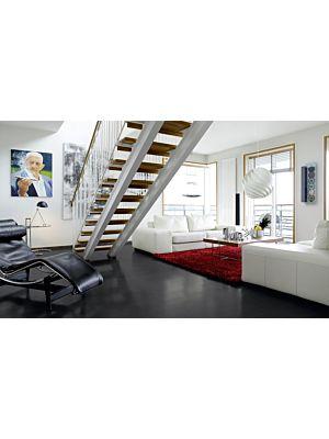 Parquet laminado de la marca pergo de la gama living expression pizarra alpaca L0320-01781 en un ambiente de habitación con vista detalle.