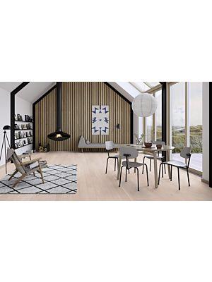 Parquet flotante de la marca Barlinek de la serie tastes of life Roble toffee en un ambiente de habitación.