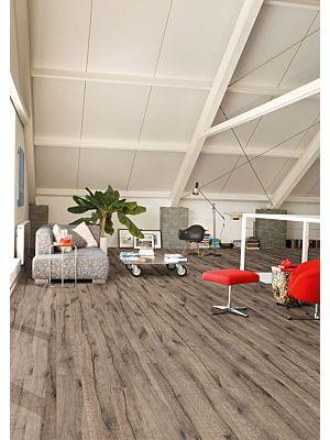 Parquet laminado de castaño oscuro mejorado de la marca quick-step de la serie perspective wide en un ambiente de habitación.