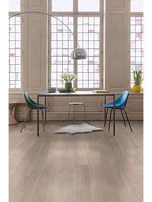 Parquet de madera natural de Quick-Step de la colección palazzo pal1473S Roble dune blanco aceitado en un ambiente de habitación.