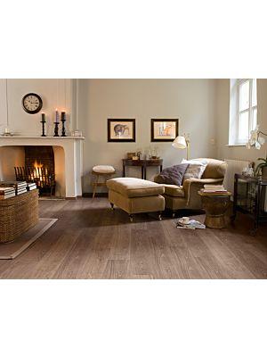 Parquet laminado de ROBLE BLANQUEADO BLANCO de la marca Quick-step de la serie CLASSIC en un ambiente de habitación.