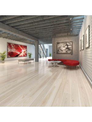 Parquet flotante de la marca Barlinek de la serie pure line Roble white truffle en un ambiente de habitación.