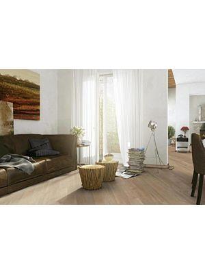Parquet flotante de la marca Barlinek de la serie pure line Fresno coffee en un ambiente de habitación.