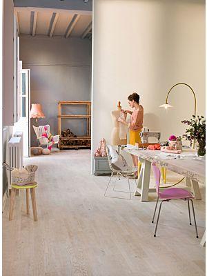 Parquet de madera natural de Quick-Step de la colección palazzo pal1338S Roble herencia mate en un ambiente de habitación.