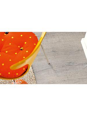 Parquet vinílico de la marca Pergo Roble moderno café V3107-40019 de la serie optimum en un ambiente de habitación.