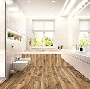 Suelo laminado Nogal perganti marrón de la marca Egger Home con código EHL075 instalado en un baño reluciente.