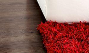 Parquet laminado de la marca pergo de la gama living expression roble beige clásico serie L0323-03359  en un ambiente de habitación.