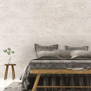 El revestimiento de pared Dekwall malta moonlight RY1N001 acabado en cera en un ambiente de habitación.