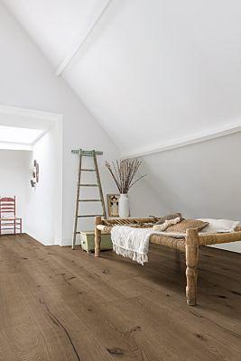 Parquet de madera natural de Quick-Step de la colección massimo mas3563S Roble tormenta invernal aceitado en un ambiente de habitación.