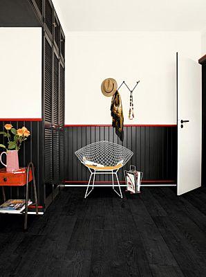 Parquet laminado de cemento gris claro im 1861 de la marca quick-step de la serie impressive  en un ambiente de habitación.