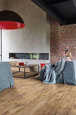 Parquet vinílico de la marca Quick-Step livyn castaño vintage claro BACp40028 de la serie Balance Click Plus en un ambiente de habitación.