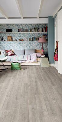 Parquet laminado de roble venecia gris de la marca quick-step de la serie eligna en un ambiente de habitación.