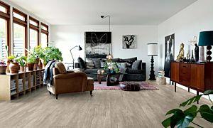 Parquet vinílico de la marca Pergo Roble gris herencia V2107-40037 de la serie premium en un ambiente de habitación.