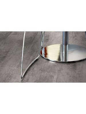 Parquet laminado de la marca pergo de la gama original excellence cemento gris L0218-01762 en un ambiente de habitación con vista detalle.