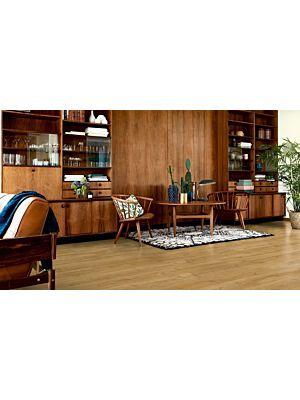 Parquet laminado roble señorial de la marca pergo de la serie living expression sensation resistente al agua superficialmente l0331-03370 en un ambiente de habitación.