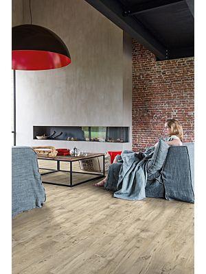 Parquet vinílico de la marca Quick-Step livyn Roble cabaña marrón oscuro BACP40027 de la serie Balance Click en un ambiente de habitación.