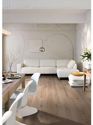 Parquet de madera natural de Quick-Step de la colección palazzo pal3092S Roble escarcha aceitado en un ambiente de habitación.