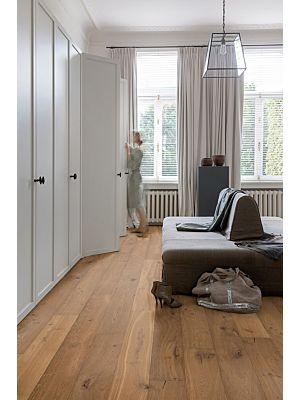 Parquet de madera natural de Quick-Step de la colección palazzo pal3095S Roble refinado extremate en un ambiente de habitación.