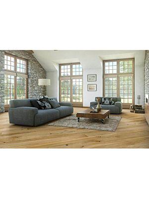 Parquet flotante de la marca Barlinek de la serie pure line Roble caramel en un ambiente de habitación.