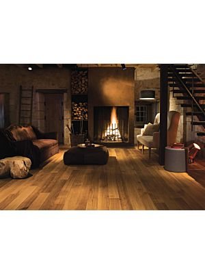 Parquet de madera natural de Quick-Step de la colección castello cas1354S roble ahumado habana mate en un ambiente de habitación.