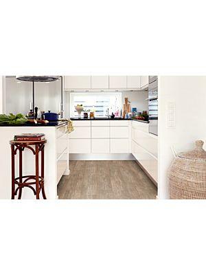 Parquet vinílico de la marca Pergo pino cabaña gris claro V2107-40054 de la serie premium en un ambiente de habitación en detalle.