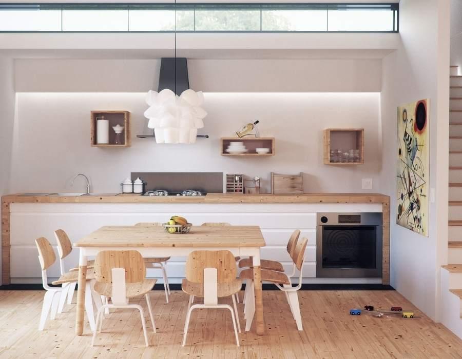 Cocina con suelo de madera color claro para dar más luminosidad